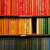 You can appreciate a colour-coded book collection.