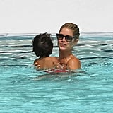 Doutzen Kroes swam in the pool with Phyllon James.