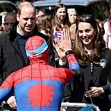 Kate gave Spiderman a high-five during a race.