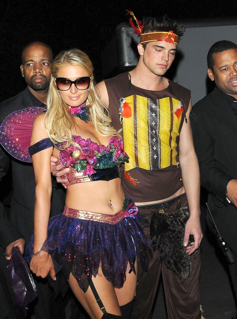Paris Hilton and her boyfriend showed off another set of costumes at Playboy's party in LA in 2012.