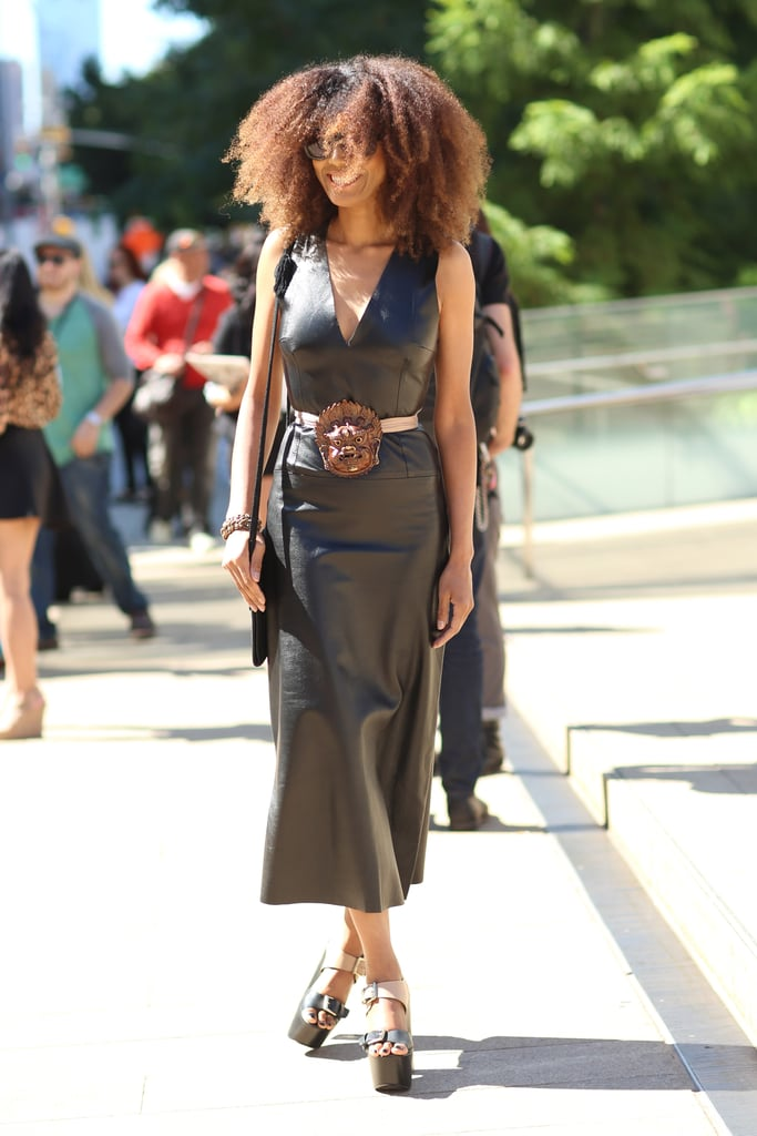 A leather sheath made all the more eye-catching with a bold belt and platforms. Source: Greg Kessler