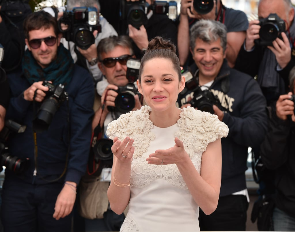 Marion Cotillard smiled while wiping her eyes in front of photographers.