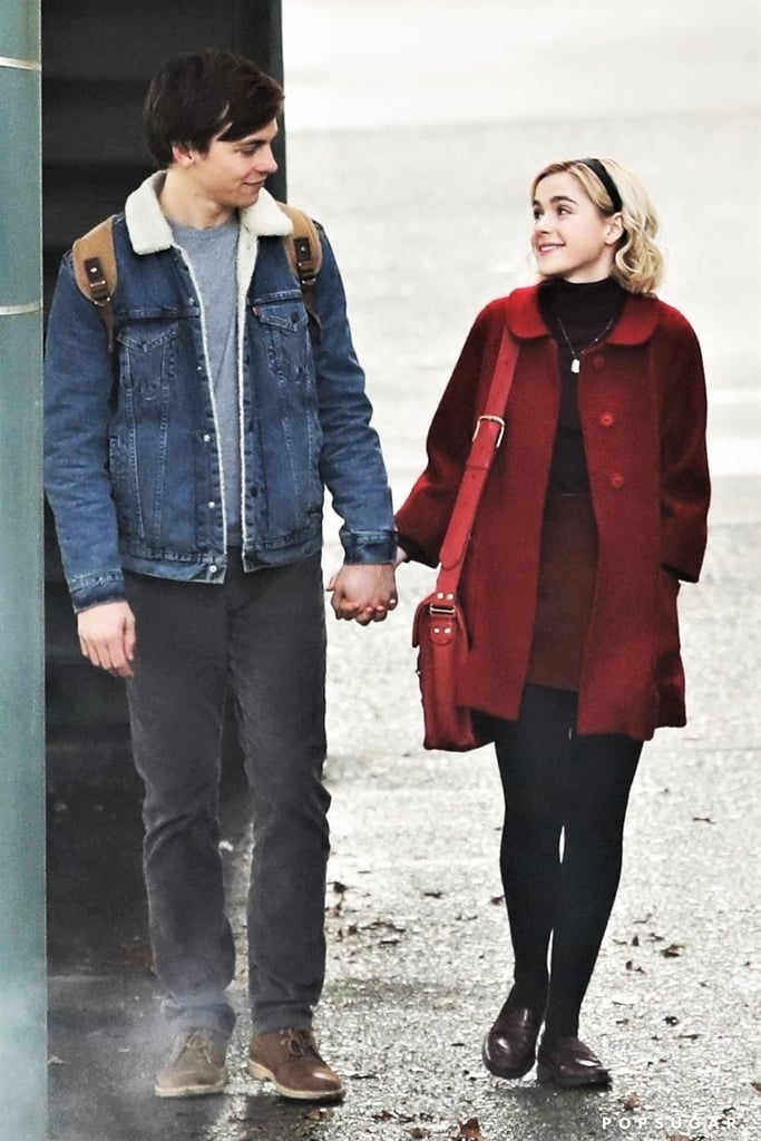 Sabrina and Harvey are together at last! On Wednesday, Kiernan Shipka and Ross Lynch got into character as they filmed Netflix's upcoming Sabrina the Teenage Witch reboot, The Chilling Adventures of Sabrina. While Lynch donned brunette locks for the scene, which was filmed in Vancouver, Shipka wore her hair in a blonde bob similar to her Archie Comics persona. And if you were any bit worried that they wouldn't be able to capture the original Harvey and Sabrina's incredible chemistry, don't fret. The costars looked all kinds of adorable as they held hands and gave each other heart eyes during their scene. We can't wait to get even more glimpses of the series as they continue filming!       Related:                                                                                                           Meet the Bewitching Cast of Netflix's Chilling Adventures of Sabrina