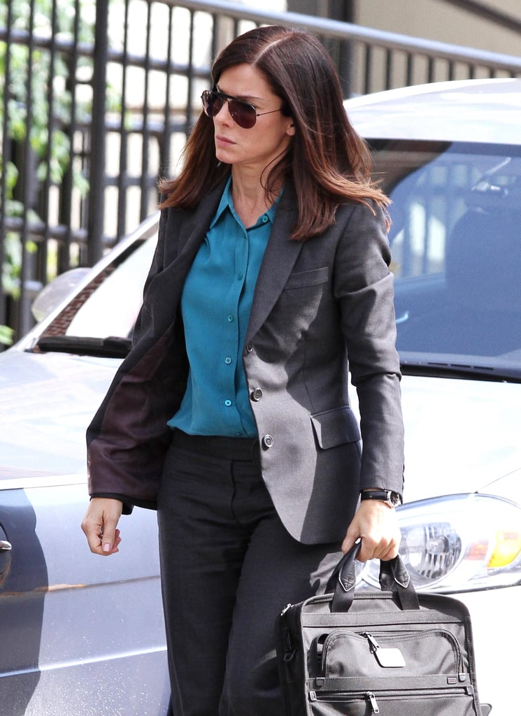 Sandra Bullock wore aviator sunglasses.