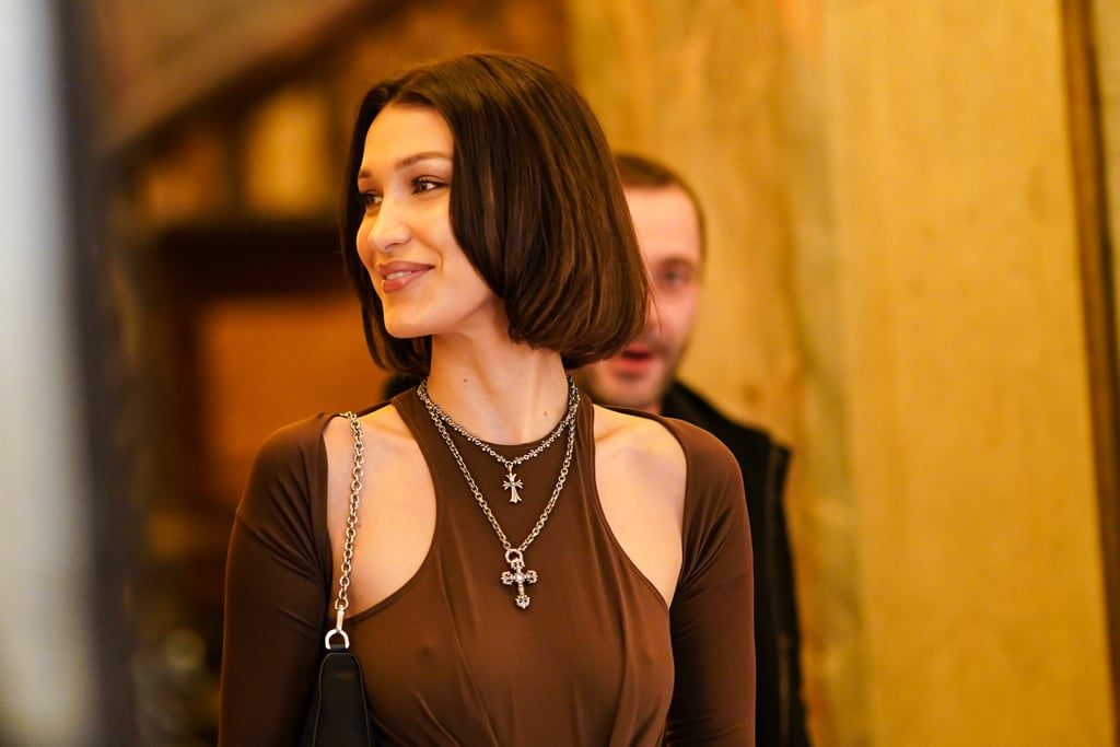 Winter beauty typically involves incorporating darker, warmer colours into our everyday looks, and Bella Hadid took that trend and ran with it. While attending Vogue's Fashion Festival Photocall in Paris on Nov. 15, the model debuted her supershort bob haircut that's basically the exact opposite of the long, dirty blond look she had before. Hadid showed off her new haircut in a hot chocolate brown blouse and dark brown makeup that perfectly complimented her new Winter look, and we can't wait to see what she pairs the gorgeous hairstyle with next. Keep scrolling to take a look at Hadid's sleek new bob from all angles ahead.      Related:                                                                                                           Emma Roberts Just Went From Brunette to Honey Blonde, and We're Obsessed