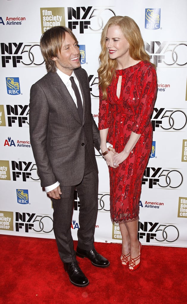 """Nicole Kidman had the company of her husband, Keith Urban, on Wednesday night on the red carpet in NYC. She was honoured with a gala tribute during the New York Film Festival, and earlier in the day, attended a screening of her new movie, The Paperboy, with director Lee Daniels. The picture is a rather controversial one, and Nicole spoke about making tough decisions about her character in order to be comfortable personally. Apparently, Lee's script had Nicole saying the n-word. She declined, and in explaining her choice referred to her son with ex Tom Cruise, Connor. She said, """"I have a son who is African American. I just didn't feel like it was right. What I try to do as an actor is fulfill a director's vision. I have opinions, but at the same time I'm not there to stop him from anything. I've really tried to do that in every film. I never want to pull them off their vision."""" Wearing a red dress from her friend L'Wren Scott, Nicole spent the evening with her husband, Keith. He was on a break from his duties hosting American Idol. He shares a seat at the judges' table with Nicki Minaj and Mariah Carey, who apparently aren't getting along too well. Keith joked that he's a mediator on Idol between the two ladies. He's currently touring the country with Mariah, Nicki, and Randy Jackson, and was able to spend time in the Big Apple supporting his wife between auditions."""