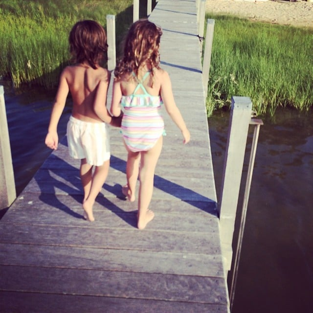 Mason Disick walked hand in hand with a friend on a dock in the Hamptons. Source: Instagram user kourtneykardash