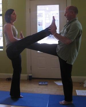 Partner Yoga Pose Facing Fence