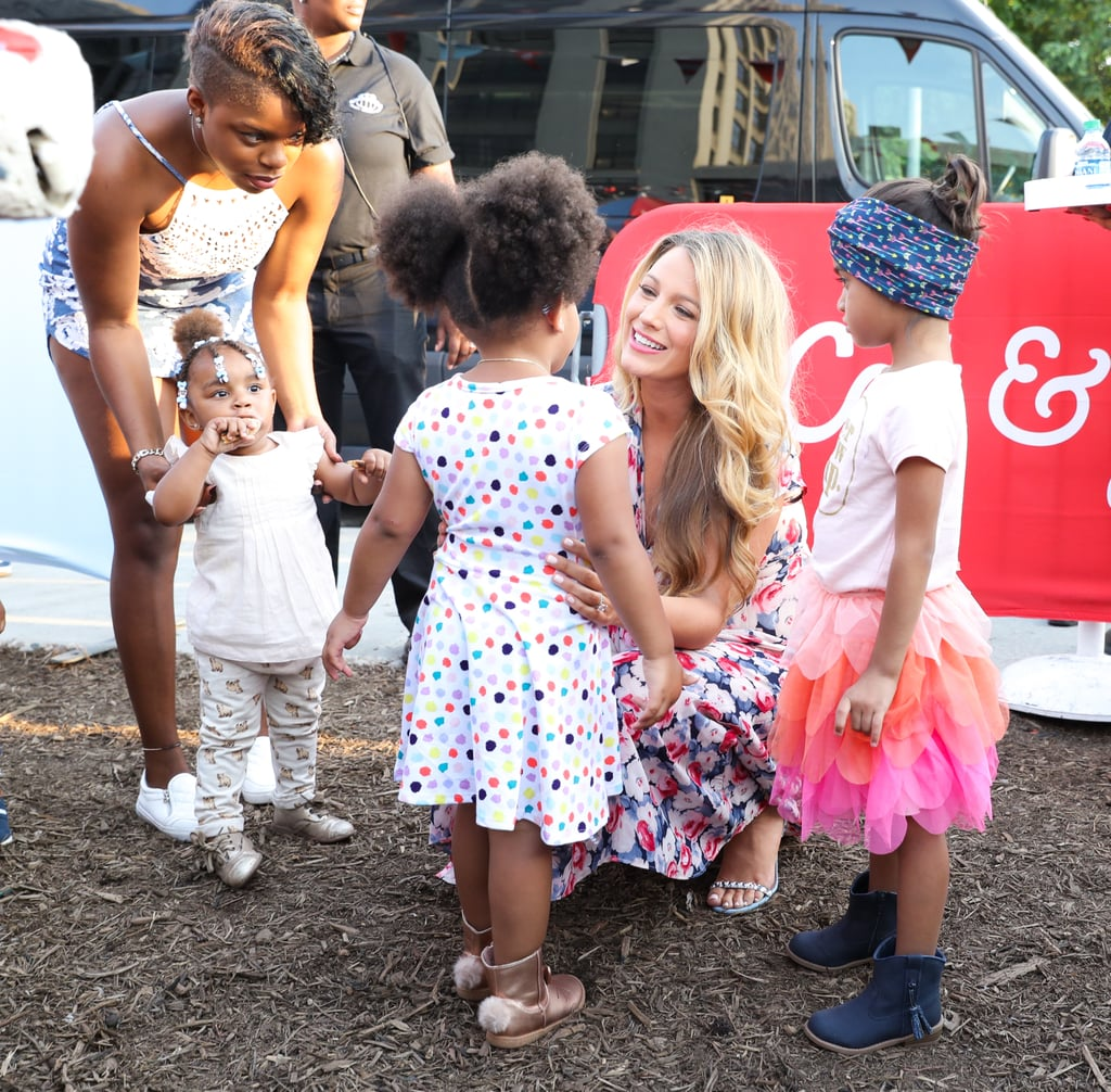 Blake Lively attended the launch of Target's newest kids' brand, Cat & Jack, at a star-studded event at Brooklyn Bridge Park in New York on Thursday. The actress, who is currently expecting her second child with husband Ryan Reynolds, put her maternal instincts on display as she hung out with some of the party's younger guests; after posing for photos in a pretty floral dress, Blake snapped selfies with fans and even knelt down on the ground to chat with a handful of adorable little girls. The soiree also brought out fellow famous moms Camila Alves, Jenna Dewan Tatum, and Rachel Bilson, who made her first public appearance in nearly a year. It's been a busy Summer for Blake, to say the least. In addition to prepping for life as a mother of two, she's also been making the press rounds to promote two new movies — shark thriller The Shallows and the Woody Allen flick Café Society, which she stars in with Kristen Stewart and Jesse Eisenberg. Most recently, Blake appeared on The Tonight Show and cracked up host Jimmy Fallon with her cute anecdotes about 1-year-old daughter James; not only is the little one having some trouble pronouncing her first few words, but she also seems to have developed a crush on Jimmy (by way of a cardboard cutout). Keep reading to see photos from Blake's latest outing, then check out five things you may not have known about her.