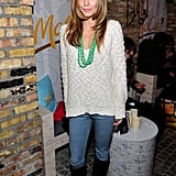 AnnaLynne McCord dressed up a knit sweater with a colourful necklace.