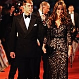 Prince William held an umbrella over Kate's head as they arrived on the red carpet for the London premiere of Steven Spielberg's War Horse in 2012.