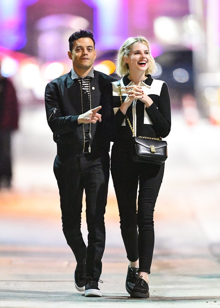 """Now that Rami Malek, 37, and Lucy Boynton, 24, have officially confirmed that they're dating, the two seem to have no problem showing off their romance. Following their adorable date night at the Golden Globes over the weekend, the couple was spotted on a sweet stroll in LA on Tuesday night. The pair looked so happy as Rami wrapped his arm around Lucy and the two shared a few laughs. They even color-coordinated their outfits for the casual outing.  Rami and Lucy recently starred together in Bohemian Rhapsody, and the Freddie Mercury biopic is receiving major praise this award season. In addition to Rami taking home the Golden Globe for best actor in a drama for his role in the movie, the film was also crowned best drama motion picture at the ceremony. Not to mention, Bohemian Rhapsody is up for three awards at Sunday's Critics' Choice Awards. Rami and Lucy certainly have a lot to be excited about right now.       Related:                                                                                                                                Rami Malek Reacts to Awkward Nicole Kidman Moment: """"This Is Probably Haunting Me on the Internet"""""""