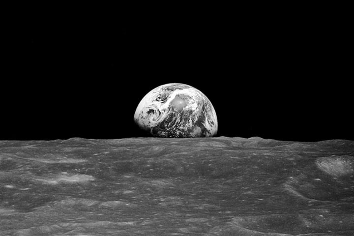 """Here we see the well-known """"Earthrise"""" photo taken on the Apollo 8 mission. As NASA explains it, """"On Dec. 24, 1968, Apollo 8 astronauts Frank Borman, James Lovell, and William Anders were coming around from the far side of the Moon on their fourth orbit. Borman began to roll the spacecraft, and as he did, the Earth rose into view over the Moon's limb. Anders, photographing the Moon from the right side window, caught sight of the view and exclaimed: 'Oh, my God, look at that picture over there! There's the Earth comin' up. Wow, is that pretty!' He snapped a black-and-white photo, capturing humanity's first view of Earth from another planetary body.""""  Source: Bill Anders/NASA"""