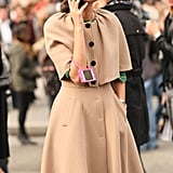 Giovanna Battaglia topped off a ladylike camel coat with a little eye candy.