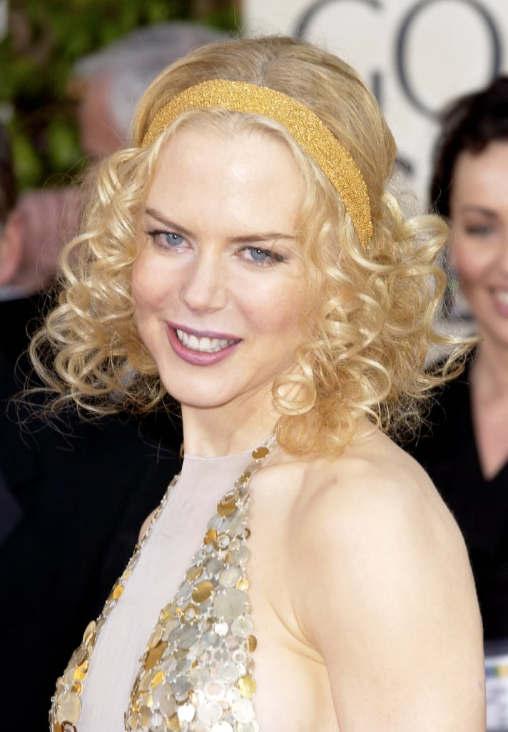 At the 2004 Golden Globes, Nicole went with tight curls that were worn with a headband for a slightly '20s vibe.