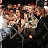 Angelina Jolie raised her glass of wine for a toast at the SAG Awards.
