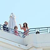 Eva Longoria gave a wave from the rooftop of a hotel where she had a photo shoot at the Cannes Film Festival.