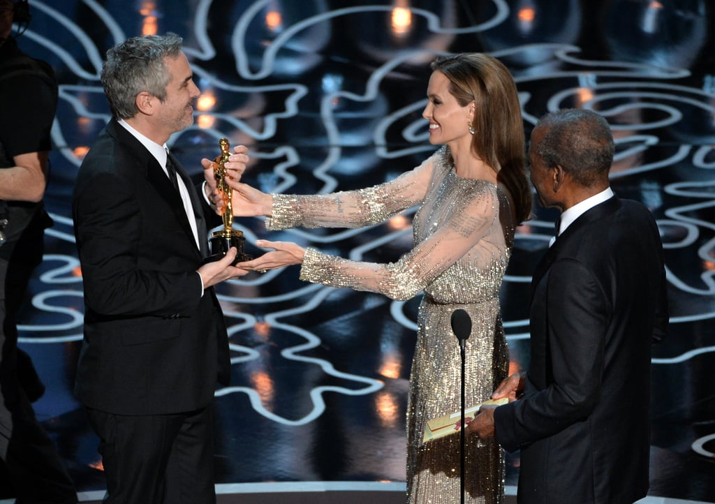 Angelina Jolie and Sidney Poitier gave Alfonso Cuarón his award.