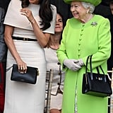 She simply accessorised her outfit with a chic black and gold belt and a matching clutch, pearl earrings, Sarah Flint pumps, and the all-important tights.