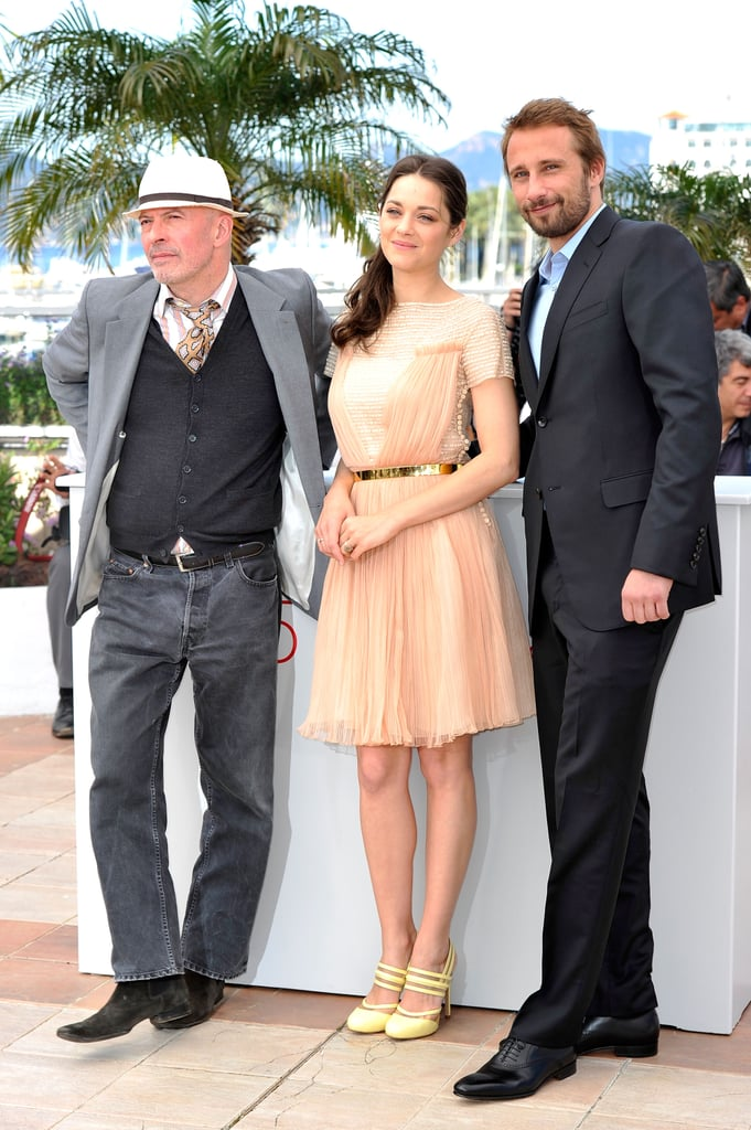 Marion Cotillard posed with costars during the Rust and Bone press conference at the Cannes Film Festival.