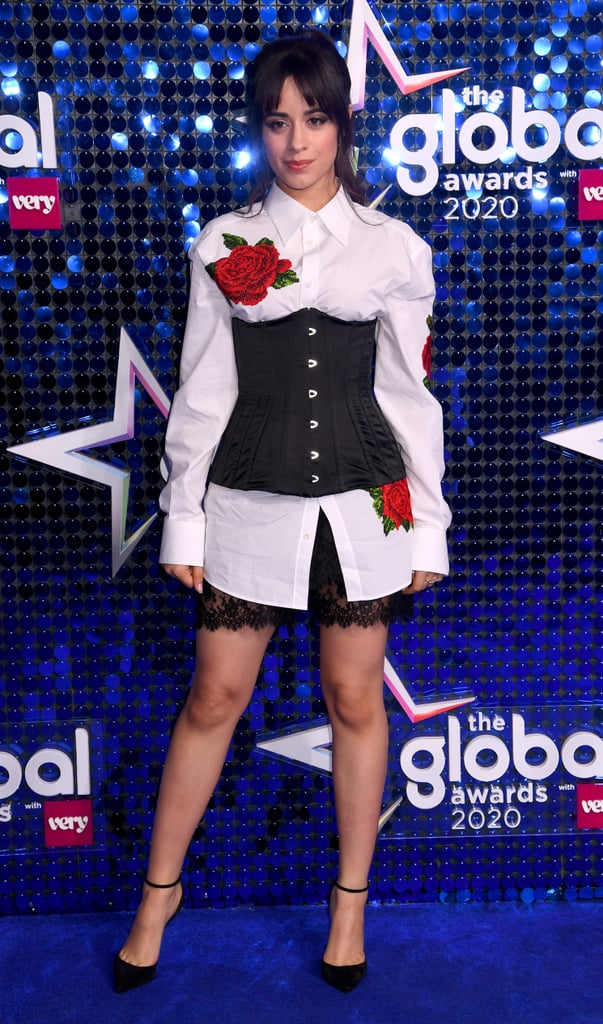 "Camila Cabello continued her reign as the Romance-inspired style queen at the 2020 Global Awards in London on Thursday in a $1,345 Dolce & Gabbana Embroidered Crepe Blouse covered in romantic red roses. The ""Living Proof"" singer paired the top — which is from Dolce & Gabbana's Fall 2020 Ready-to-Wear Collection — with a Dolce & Gabbana Satin Corset ($995), Dolce & Gabbana Sheer Chiffon Shorts ($575), and Christian Louboutin Uptown 100 Leather Pumps ($771).  Adding a little sparkle to the look, Camila accessorised the corset trend with Sara Weinstock Reverie Couture Earrings ($13,805), a Sara Weinstock Donna Pave Ring ($3,785), and a Graziela Double Natura Ring in White Gold ($3,750). For anyone keeping track, this outfit costs somewhere in the realm of a casual $25,000. Whoa. Keep scrolling to take a look at Camila's romantic outfit."