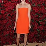 Nora Zehetner in a bright orange dress.