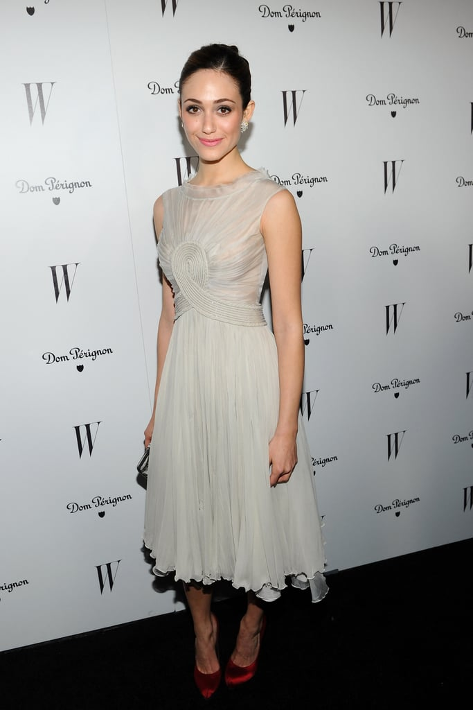 Emmy Rossum played up the contrast on her Georges Hokeika dress with her ruby-red Ferragamo pumps.