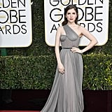 Anna Kendrick in a one-shoulder Vionnet gown with a floor-sweeping train, a Tyler Ellis clutch, and Neil Lane jewels in 2017.