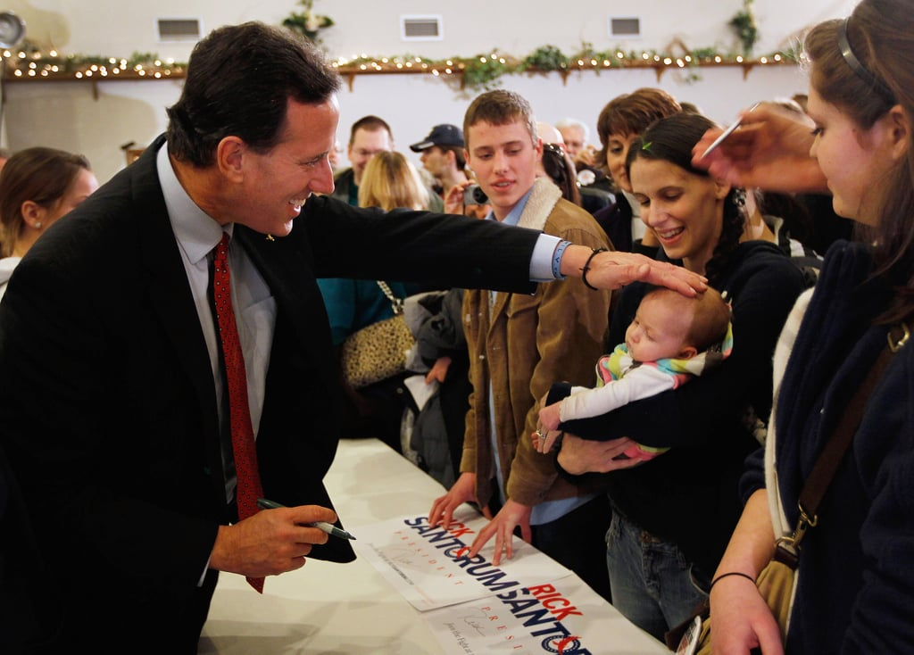 Former US Senator Rick Santorum greeted a supporter and her tot during a stop in Davison, MI, in February.