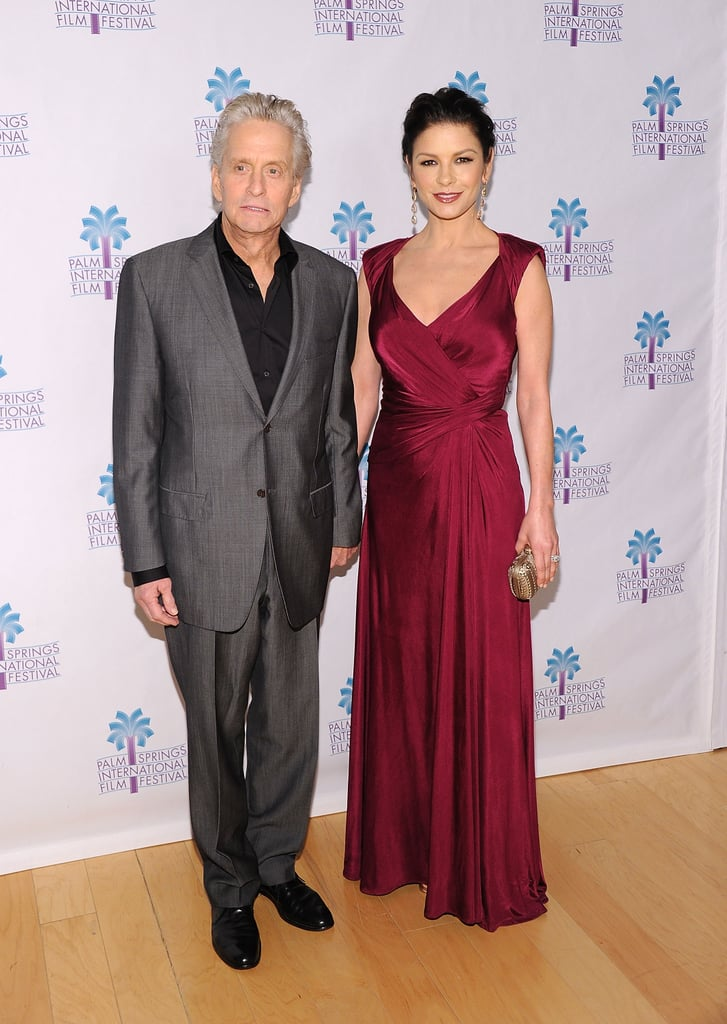 Michael Douglas and an elegant Catherine Zeta-Jones stuck side-by-side on the red carpet this evening at the Palm Springs Film Festival, where he was presented with the Icon Award for his amazing career. Earlier this week the actor shared the good news that he's currently cancer free after undergoing seven weeks of radiation and chemotherapy. He's also getting ready to return to work portraying Liberace in an upcoming biopic. Douglas says he's been studying up on the performer, whose lover will be played by Matt Damon. The Palm Springs Film Festival kicked off with a star-studded gala over the weekend, and it's rolling on by honouring a healthy, and happy Michael Douglas.