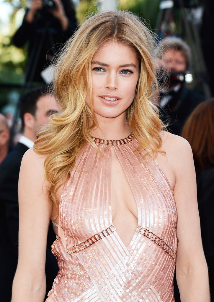 "Doutzen Kroes attended the Le Passé premiere wearing a sparkling blush gown, which she paired with a ""no-makeup"" makeup look. First, her skin was perfected using Colour Caresse Wet Shine Stain in Pink Resistance ($10), completed her luminous look."