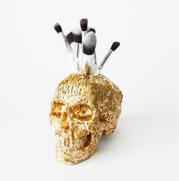Pluto 99 Carved Tribal Skull Makeup Brush Holder ($77, originally $129)