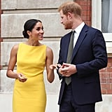 July: Meghan grabs the spotlight in a bright yellow dress for a youth reception with Harry.