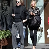 Kate Moss walked side by side with her friend James Brown in London.