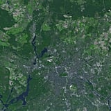 Berlin, Germany, from above is a mix of urban landscape and thick greenery.