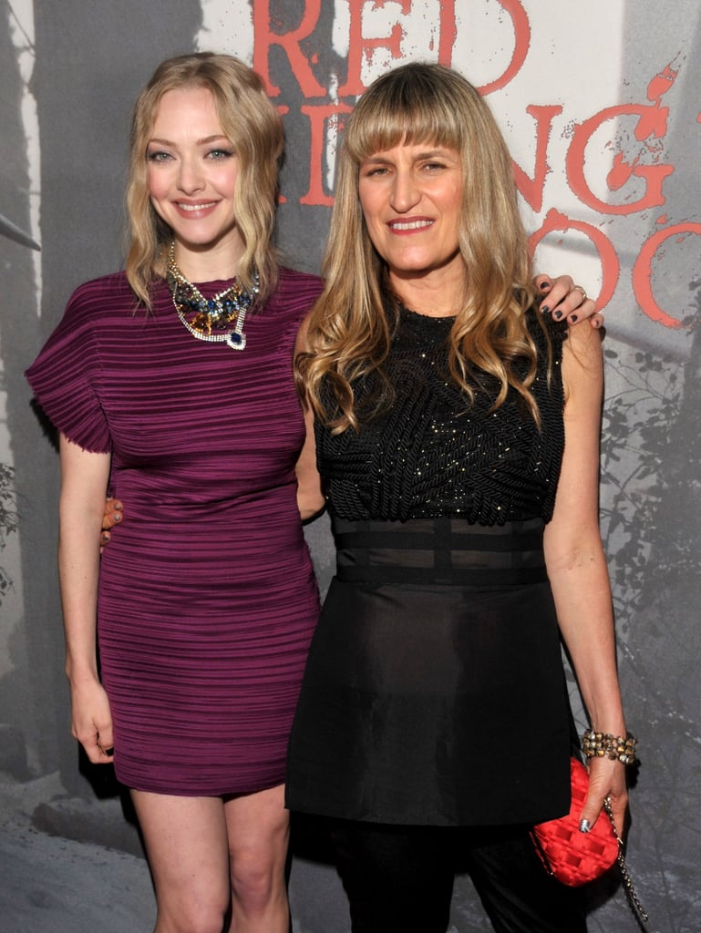 Amanda Seyfried chose purple Lanvin for the premiere of her dark new film Red Riding Hood at Mann's Chinese Theater last night in LA. The debut also drew Breaking Dawn's Nikki Reed and American Idol's final 13. Elle cover girl Amanda wasn't with her real-life love, Ryan Phillippe, on the red carpet. Instead, she posed with her two sexy leading men, Shiloh Fernandez and former model Max Irons. The spin on the classic fairy tale was helmed by Twilight's Catherine Hardwicke, who years ago chose Shiloh as a finalist for the part of Edward Cullen. The actor said it took three auditions before Catherine finally cast him in one of her movies, but that it was worth the wait. Catherine, meanwhile, told us Amanda was the perfect pick for the part of Red. The director also talked about her former leading lady, Kristen Stewart, who is starring in another adaptation of a Brothers Grimm tale — Snow White. She revealed that Kristen will kick ass in the role, which makes the heroine less of a damsel in distress than past versions. Check out today's PopSugar Rush for even more from our interviews with Catherine and the cast!
