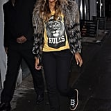 Ciara fused a cheeky printed tee with a plush fur coat and then completed her London look with flat lace-up boots.