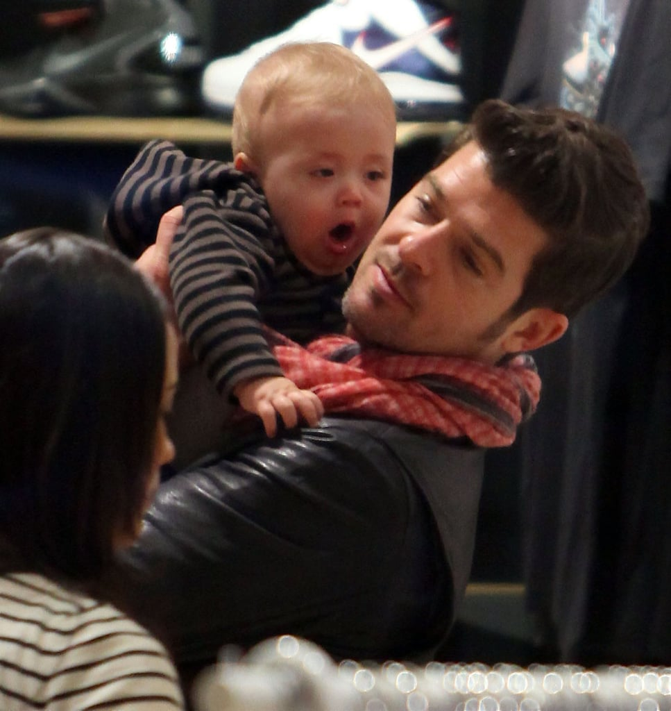 Robin Thicke and Paula Patton brought baby Julian to Barneys in LA last night. The proud parents are gearing up for their son's first holiday season with the last-minute shopping trip after welcoming him in the Spring. Robin's been taking care of things at home while Paula's been filming Mission: Impossible 4 in Vancouver, and now that the trio is back together they can enjoy the special time of year as a family.