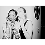 The two posed for a photo with some Champagne.  Source: Instagram user badgalriri