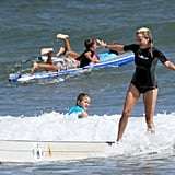 Reese Witherspoon surfing.