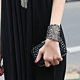A laser-cut cuff and textured black clutch coupled up for an almost-gothic vibe.