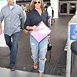 In June 2017, Jennifer wore a polka-dot blouse with ripped boyfriend jeans and espadrilles.