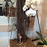 I have metal Mexican cross I use to display my necklaces on that sits on a wooden sideboard in my dressing room.