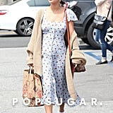 For an Easter church service in April, Selena wore a floral dress from Reformation. She dressed down the casual look with a cozy Free People cardigan, white Puma sneakers, and Jennifer Fisher hoop earrings. She carried a Coach bag.
