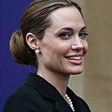Angelina Jolie flashed a smile upon arriving to the Lancaster House in London for the G8 Foreign Ministers' conference.