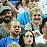 Kirsten Dunst was all smiles at the game with a friend.