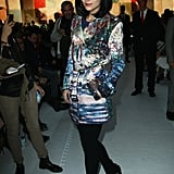Leigh Lezark donned a bold-printed trench coat — and wore the coat as a dress for maximum effect — to the Paul & Joe show.