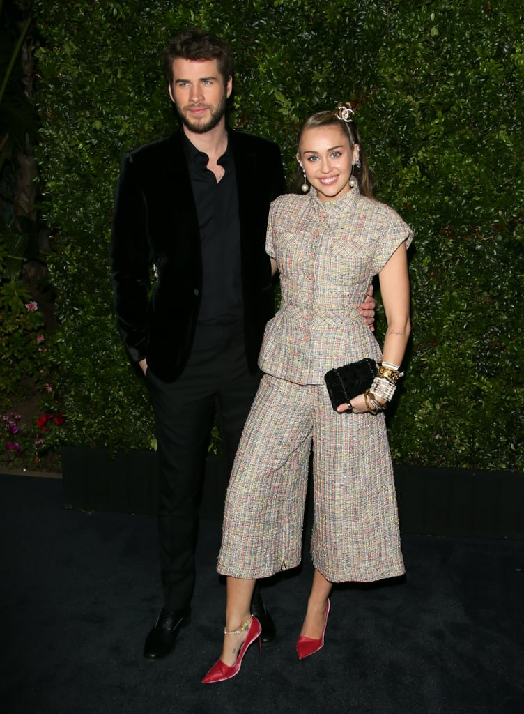 "Oscars weekend is in full swing, and Miley Cyrus is ready to get her glam on. The 26-year-old singer stepped out with husband Liam Hemsworth on Feb. 23 for the Chanel and Charles Finch preparty. She chose to honour the late designer Karl Lagerfeld from head-to-toe with her tweed Chanel outfit and matching accessories. Miley was one of many stars who paid their respects after Karl died, and she continued to do so at the Beverly Hills event.  ""When I went to my fitting yesterday with Chanel I was wearing a pin he had given me when we had shot together just a couple of years ago,"" Miley told Women's Wear Daily. ""I was wearing this jacket and he had put it on there; I had never taken it off before and I wore it going into the store and coming here tonight so this just feels full circle, and feels like an honor."" Miley wore a variety of Chanel jewellery, including a crystal-embellished brooch, which she wore as a hair pin. She paired her collection of bracelets and rings with a tweed Chanel suit from the line's Spring/Summer 2019 collection, and tied the whole look together with a pair of Stella McCartney heels. Check out more snaps of her look ahead."