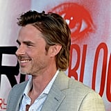 Sam Trammel arrived at the season five premiere of True Blood in a grey suit.