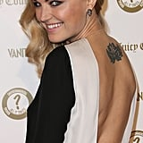 Malin Akerman wore a low-backed dress.
